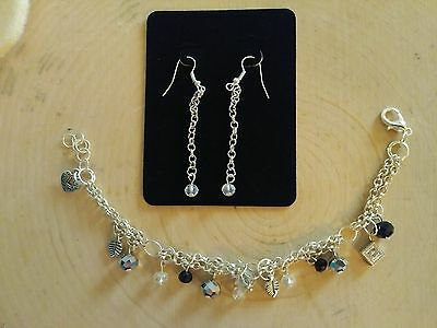 Womens silver plated charm bracelet and dangle earring set