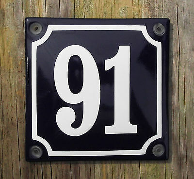FRENCH ENAMEL HOUSE NUMBER SIGN. WHITE NUMBER 91 ON A BLUE BACKGROUND, 10x10cm.