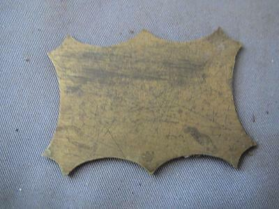 Old solid brass shield insert for a writing box.