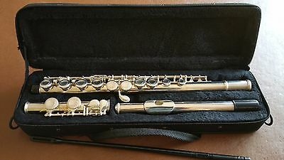 Silver plated flute with case. Good condition.