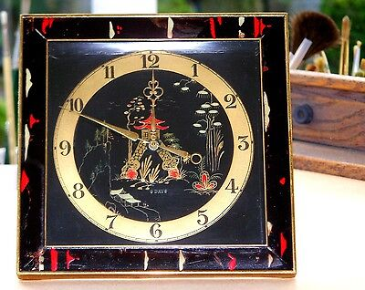 A FINE 1920s antique vintage CHINOISERIE strut mantel clock in GOLD BLACK & RED