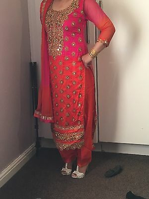 asian mehndi outfit.. burnt Orange colour with pink and antique gold embroidery