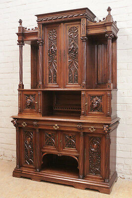 GOTHIC CABINET IN HEAVILY CARVED WALNUT FROM FRANCE c1870's
