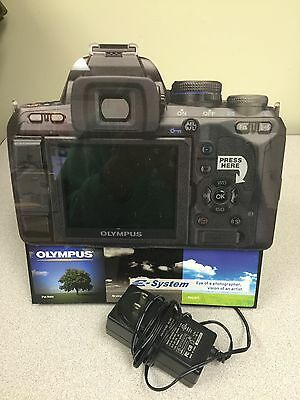 Olympus Camera Shaped Counter Display with Video Presentation - Sign / Display