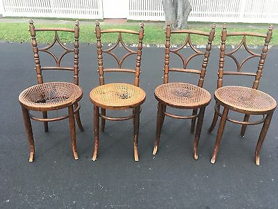 Set of four Antique Austrian Bentwood chairs in need of recaning.