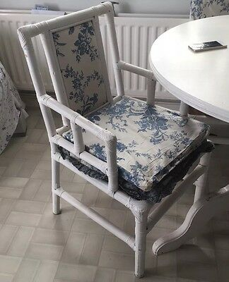 A Set Of 4 Vintage bamboo chairs with Beautiful Fabric Panels & Vintage Cushions