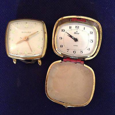 2 old clocks Bayard and Starlet