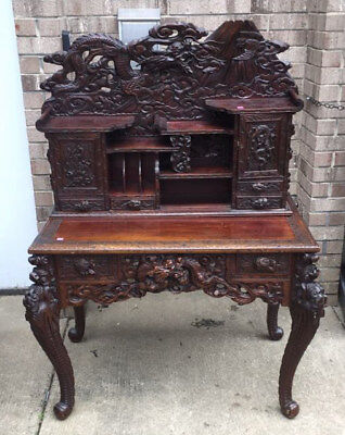 Ornate Asian carved two piece desk. Lot 95