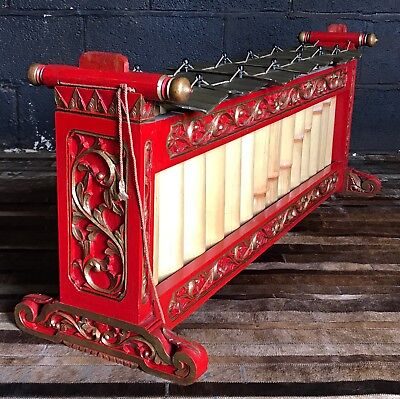A Red Lacquer And Gilt Wood And Brass Plate Xylophone