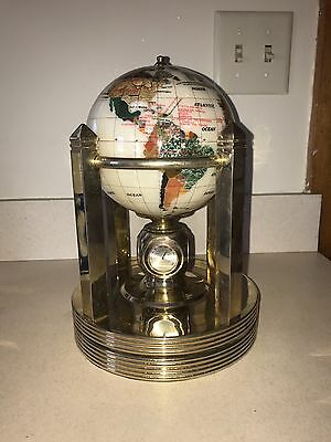 mother of pearl globe on rotating stand & clock
