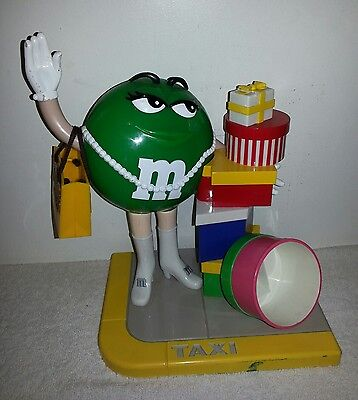 M&M candy dispenser toys World shopping spree green lady taxi