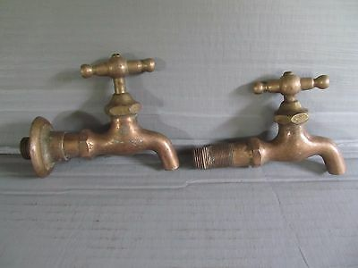 two used Vintage Solid Brass Faucets