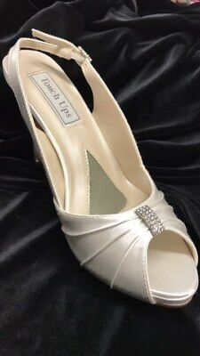 Touch ups Iris white satin shoe with a 3.25 inch heel size 7.5