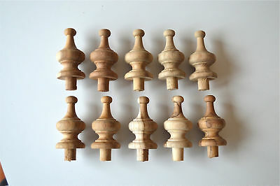 A set of 10 2 1/4 inch antique hardwood turned finial furniture clock F13