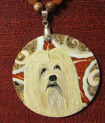 Lhasa Apso hand painted on large, roung, decorated composite pendant/bead/neckla