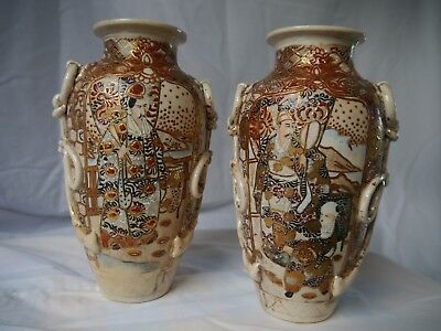 Matching Pair of Ornate Oriental style Vases