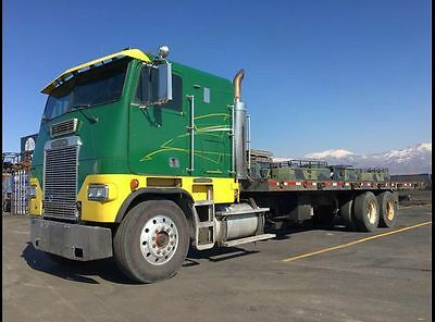 1989 Freightliner Cab Over Rollback tow truck with sleeper and stinger hitch