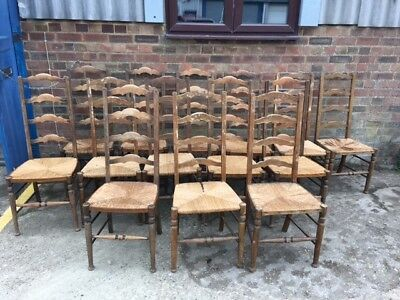 A set of 14 French Ladder back rush seat chairs for restoration