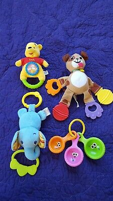 Lot of 4 baby toys (teethers, rattle, ect.)