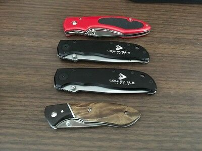 Lot of 4 used folding pocket knives(China)