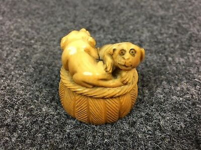 Antique Japanese Netsuke Hand Carved Yin Yang Dogs on a Bed