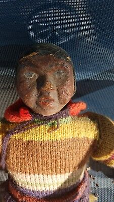Large early Inuit doll 18inches. Head is carved wood or composition. Fur legs .