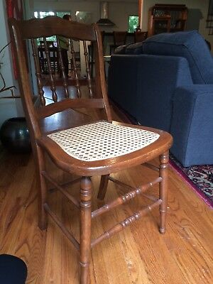 Antique Vintage Wood Ladder Back Chair With Cane Seat.  Cane in great condition.