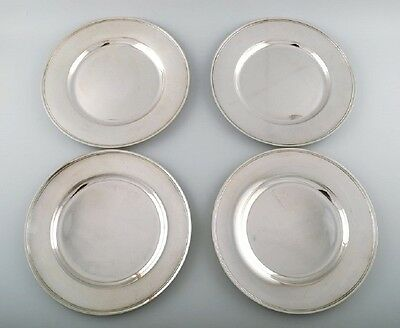 Four Evald Nielsen, Denmark cover plates in hammered sterling silver.