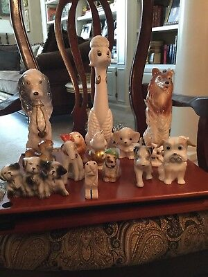Lot of dog figurines and 1 bird