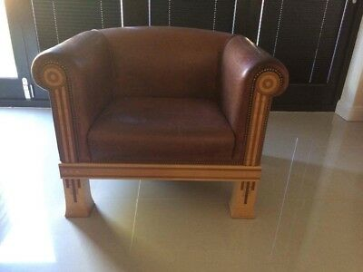 Two Antique Tan Leather Cigar Armchairs