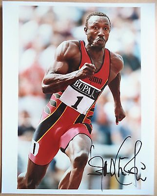 LINFORD CHRISTIE - 1992 OLYMPIC GAMES 100m GOLD MEDAL SIGNED PHOTOGRAPH