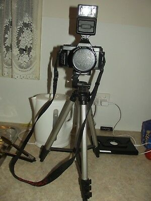 pentax camera with lens and tripod