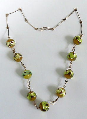 An Edwardian Gold Tone Flat Wire & Green Foil Glass Necklace