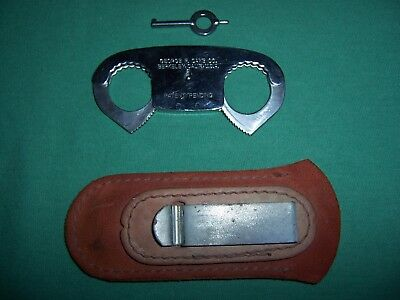 Vintage George F. Cake CO Berkeley,Calif.,U.S.A. thumb cuffs with key and pouch