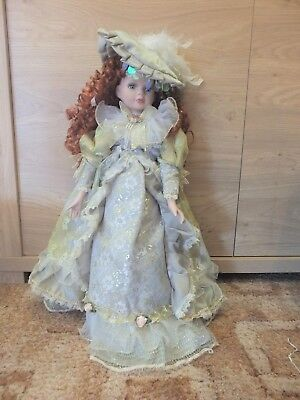 22 inch  PORCELAIN DOLL with Handmade Dress