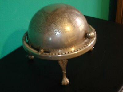 Silver plated butter/caviar dish with roll-top dome cover.
