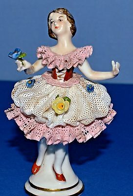 Miniature Porcelain Figurine - Lady Holding A Blue Flower