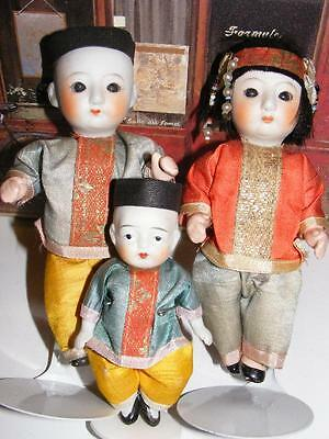 FAMILY of 3 ANTIQUE ASIAN BISQUE Jointed DOLLS in Traditional Oriental Costumes