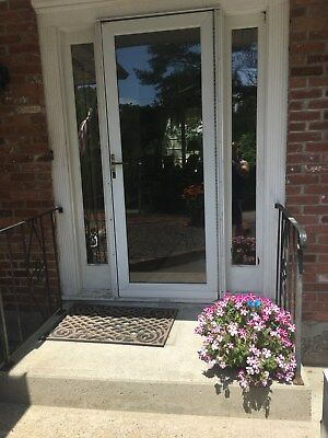 "Front Exterior Entry Single 32"" Door with Two Sidelites and storm door."
