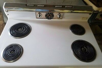 1960,s GE electric stove, in good working condition, has a warming area, clean