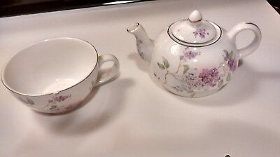 Fine Bone China.  Crown Victorian, Staffordshire England. Cup and creamer.