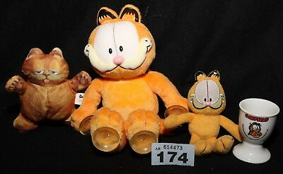 Lot 173 Garfield: soft toy, keyring, egg cup and one from Garfield 2 bundle