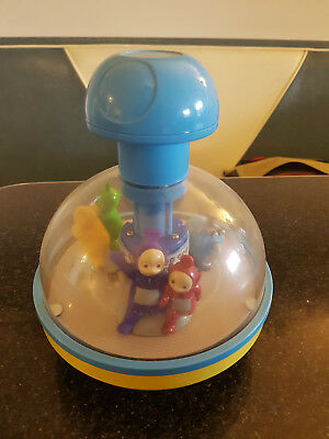 Vintage TELETUBBIES Tubby Go Round spinning carousel with bell
