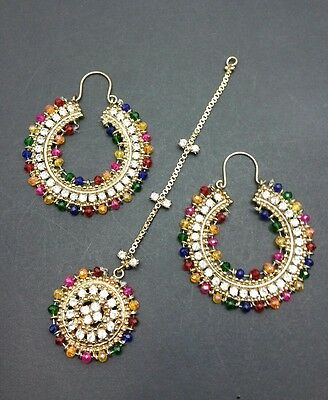 Manjoos (multicolours) Earrings and tikka set in gold. Mendi function