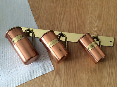Set of 3 Copper Measuring jugs with hanging rack