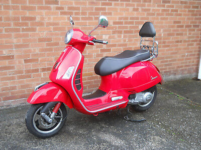 Red 2010 Vespa GTS 300ie Super Excellent condition 13523 miles  No rust on seams
