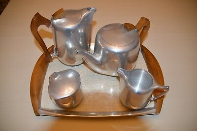 Picquot ware four piece tea set with tray