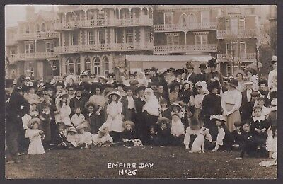 Postcard Empire Day large group in front of elaborate balconies RP unlocated
