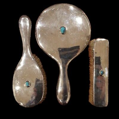 Liberty Cymric silver hand mirror and brushes, style of Archibald Knox