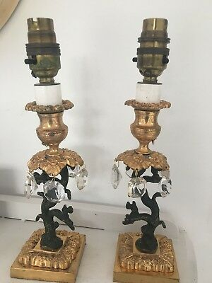 pair of gilt  antique black iron bronze table lamps with crystals